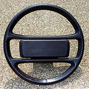 4 spoke leather wrapped steering wheel